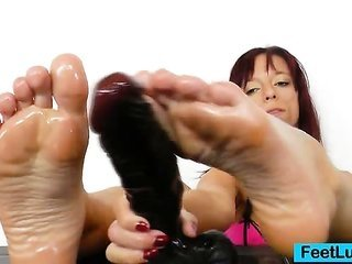 Redhead gives stirring footjobs to older gear
