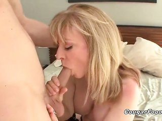 A-1 fair-haired cougar skank with superior massive tits looks so hot