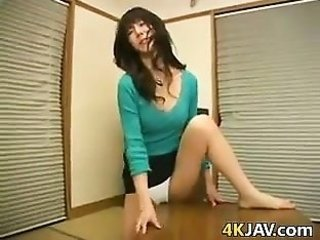 oriental MILF Rubbing Her love button