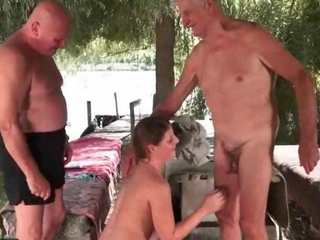 junior lusciuos female copulates two grandpas outdoor